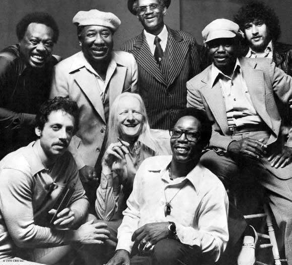 Standing L-R Jimmy Rogers, Muddy Waters, Walter Horton, Pinetop Perkins & Bob Margolin Seated L-R Jerry Portnoy, Johnny Winter & Willie 'Big-Eyes' Smith