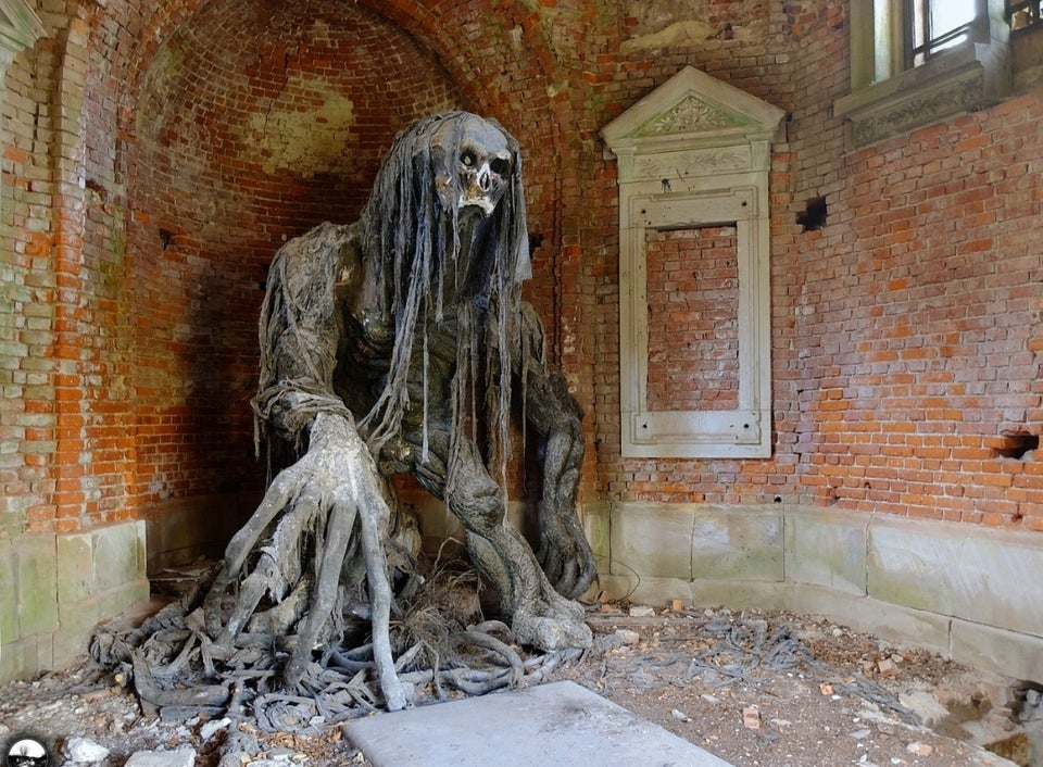 Creepy statue in abandoned mausoleum in Poland