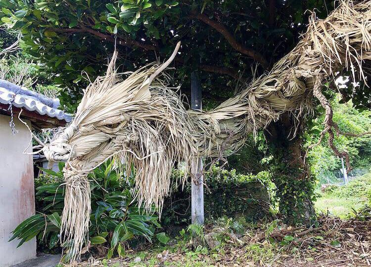 A dragon made from palm leaves and wood